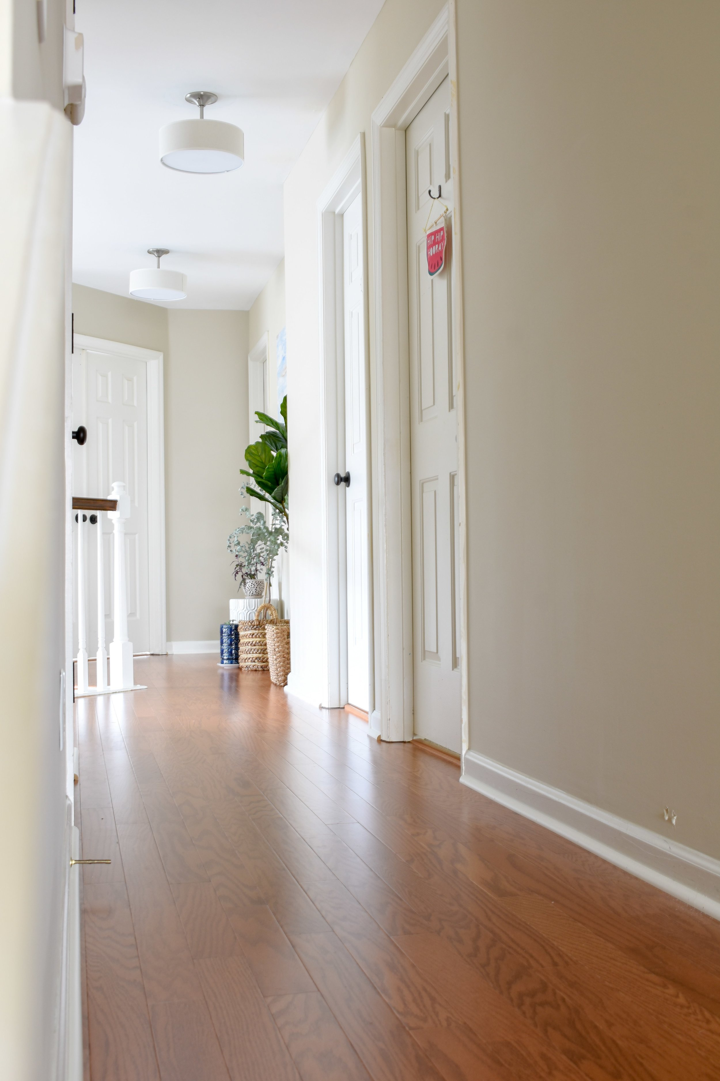 We added hardwood flooring on the stairs and in the upstairs hallway to replace the old carpet.