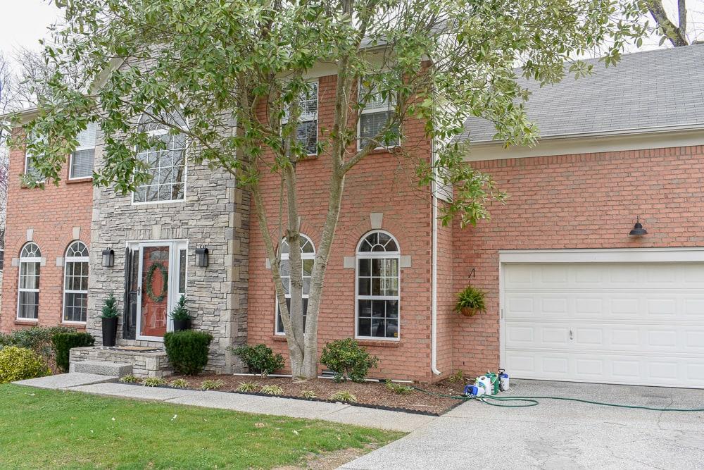 suburban brick home exterior - we have a pink brick and stone facade