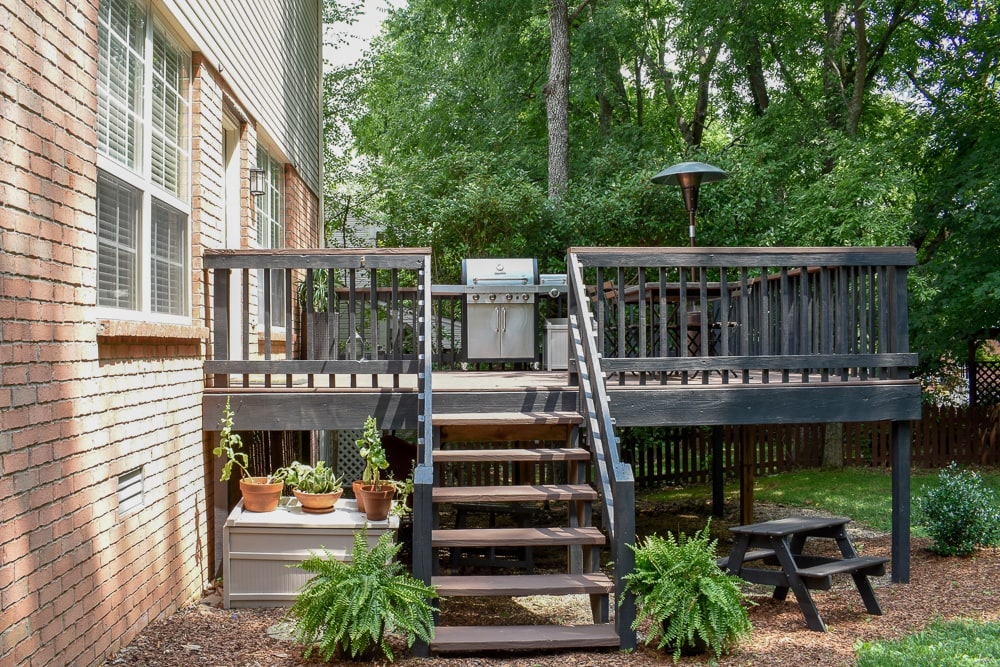 backyard makeover - here's how we updated this patio and turned our backyard into a forest oasis