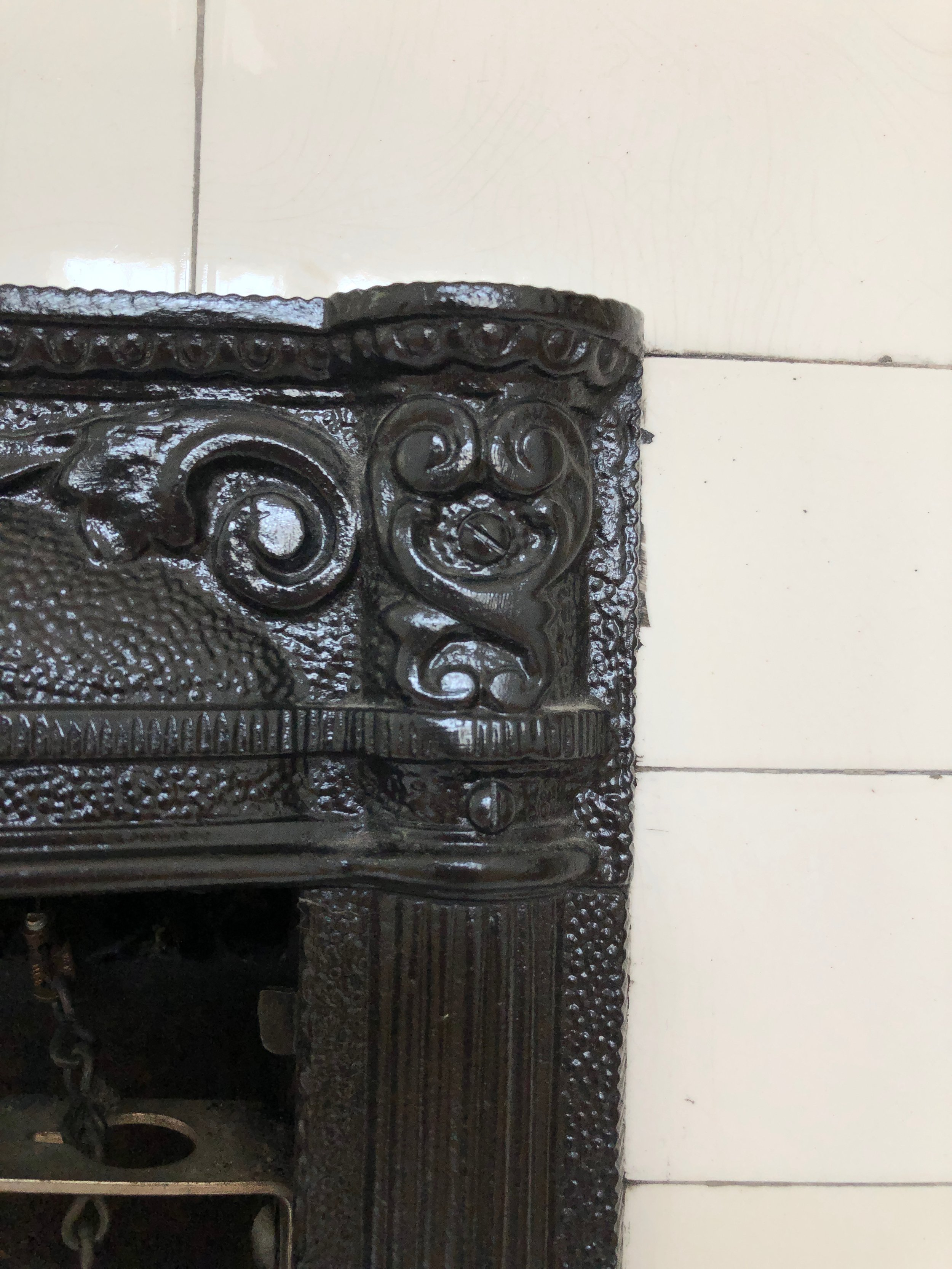 The original subway tile surrounding the fireplace in our 1924 bungalow has that crackle finish that can't be replicated today. We adore it, so we're going to try our best to save it as we renovate.
