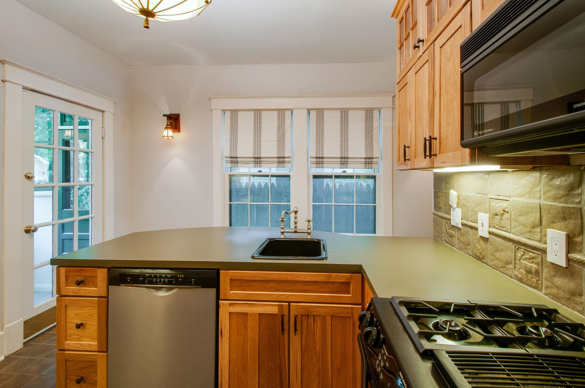 Our 1920s Bungalow Kitchen - this space has been renovated out of its period charm. We plan to restore it.
