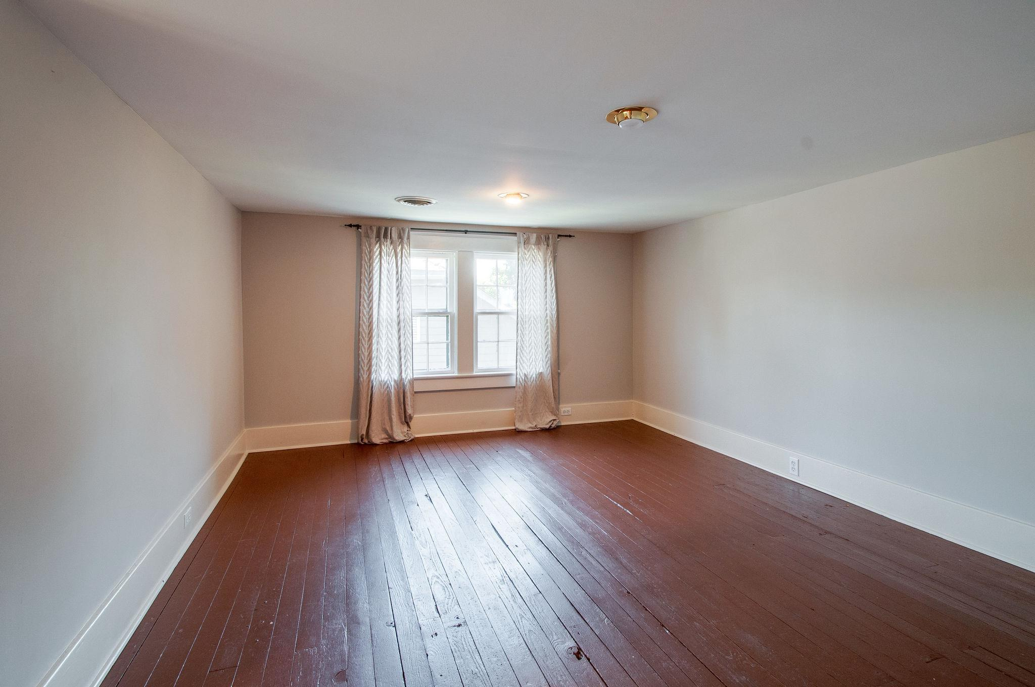 Large upstairs bedroom in a historic home