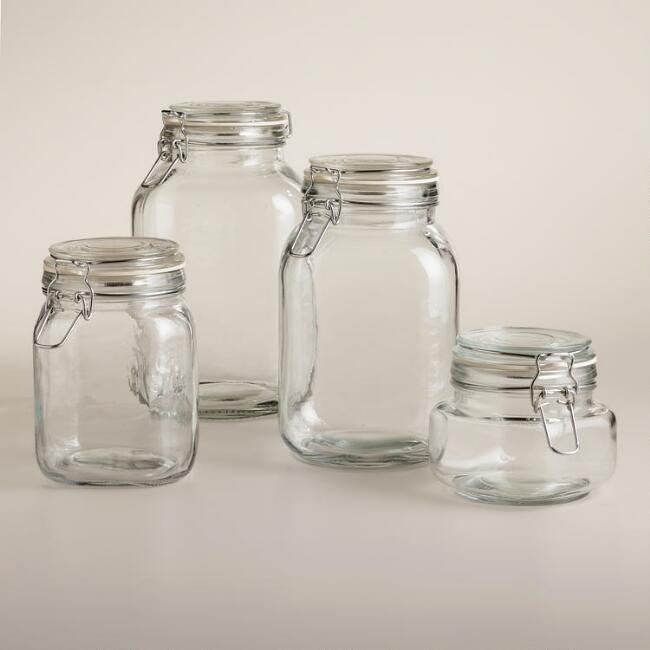 store laundry soaps in glass jars for a cleaner look in a utilitarian space