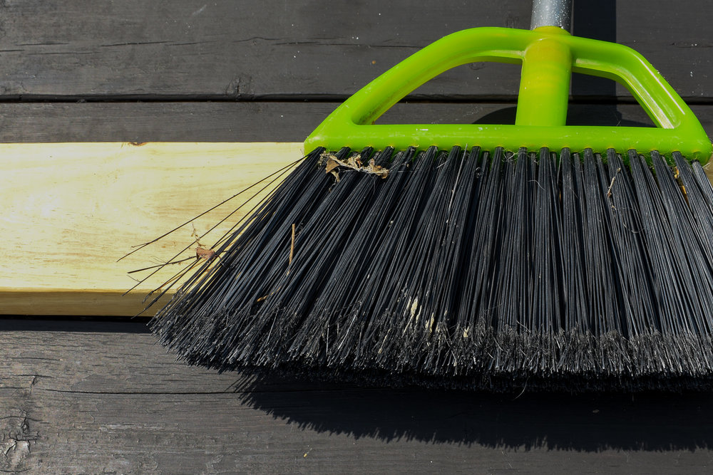DIY WOOD BROOM STEP ONE: Using your existing broom as a guide, determine the approximate width of your new broom head. Mark your cut lines on your scrap 2x4.