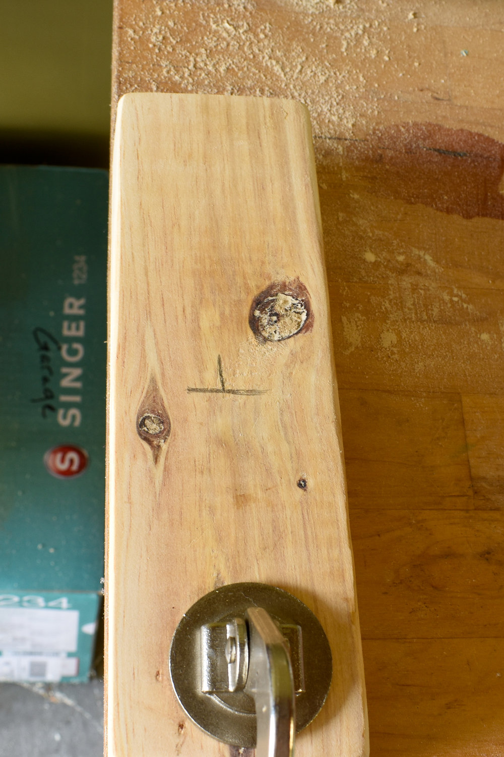 drilling a pilot hole to accomodate a broom stick - DIY BROOM PROJECT