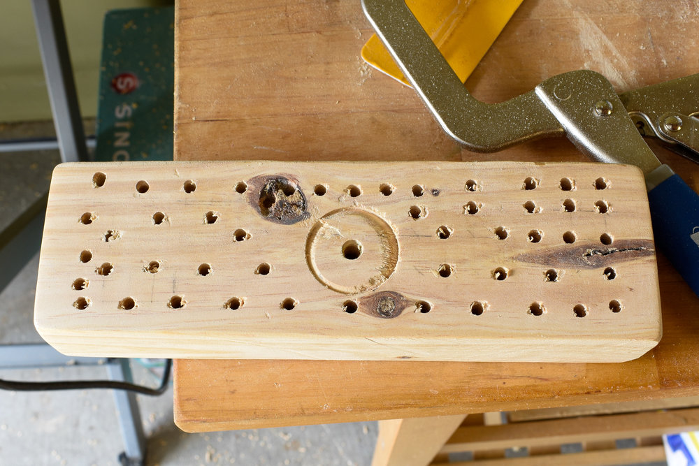 """DIY BROOM TUTORIAL: STEP SEVEN: Using the 3/8"""" drill bit, create approximately 3/8"""" deep holes along your grid pattern. This is where your bristles will attach to the underside of your broom. Alternate the spacing for a fuller bristle look."""