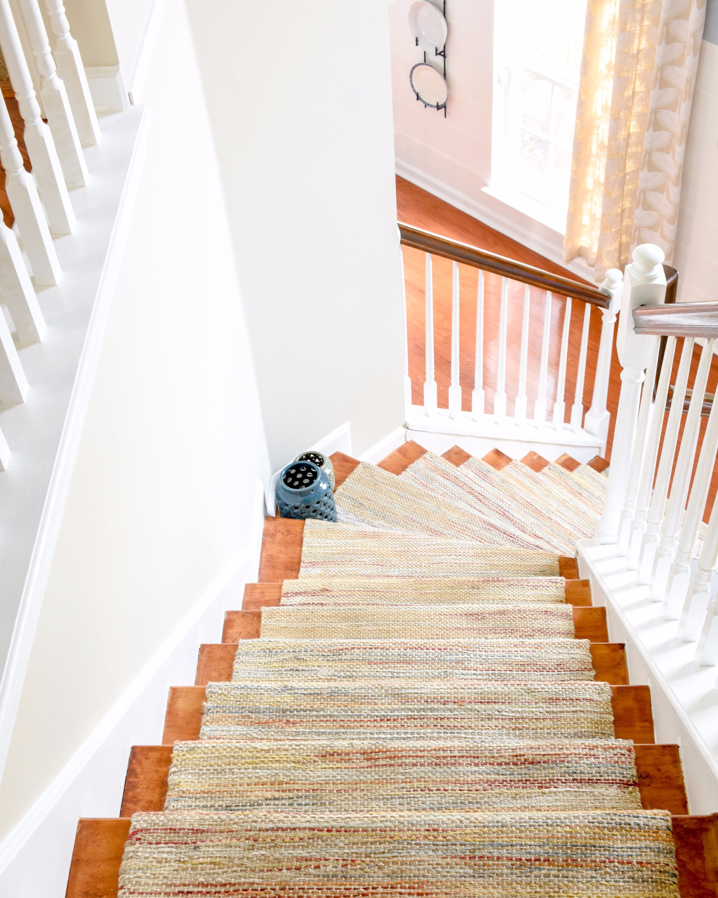 staircase makeover - removing old carpet and adding hardwood with a permanent runner made from store-bought rugs