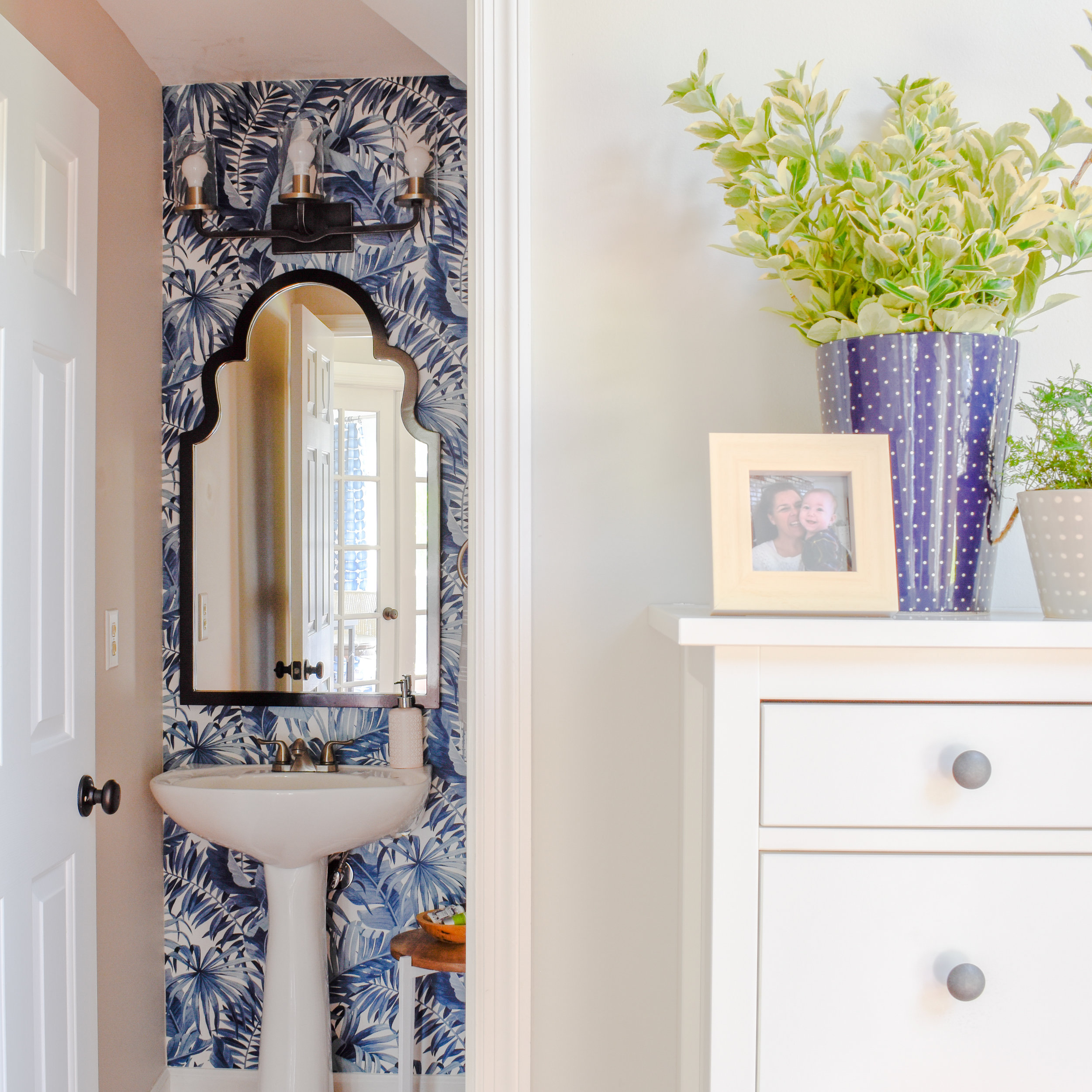 navy blue wallpaper on a bathroom accent wall