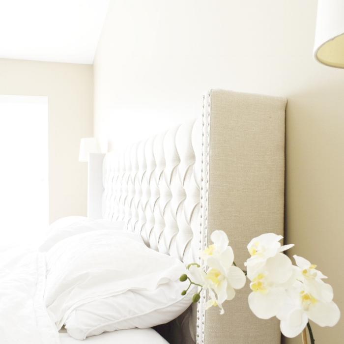 bright+neutral+bedroom+with+tufted+headboard.jpg