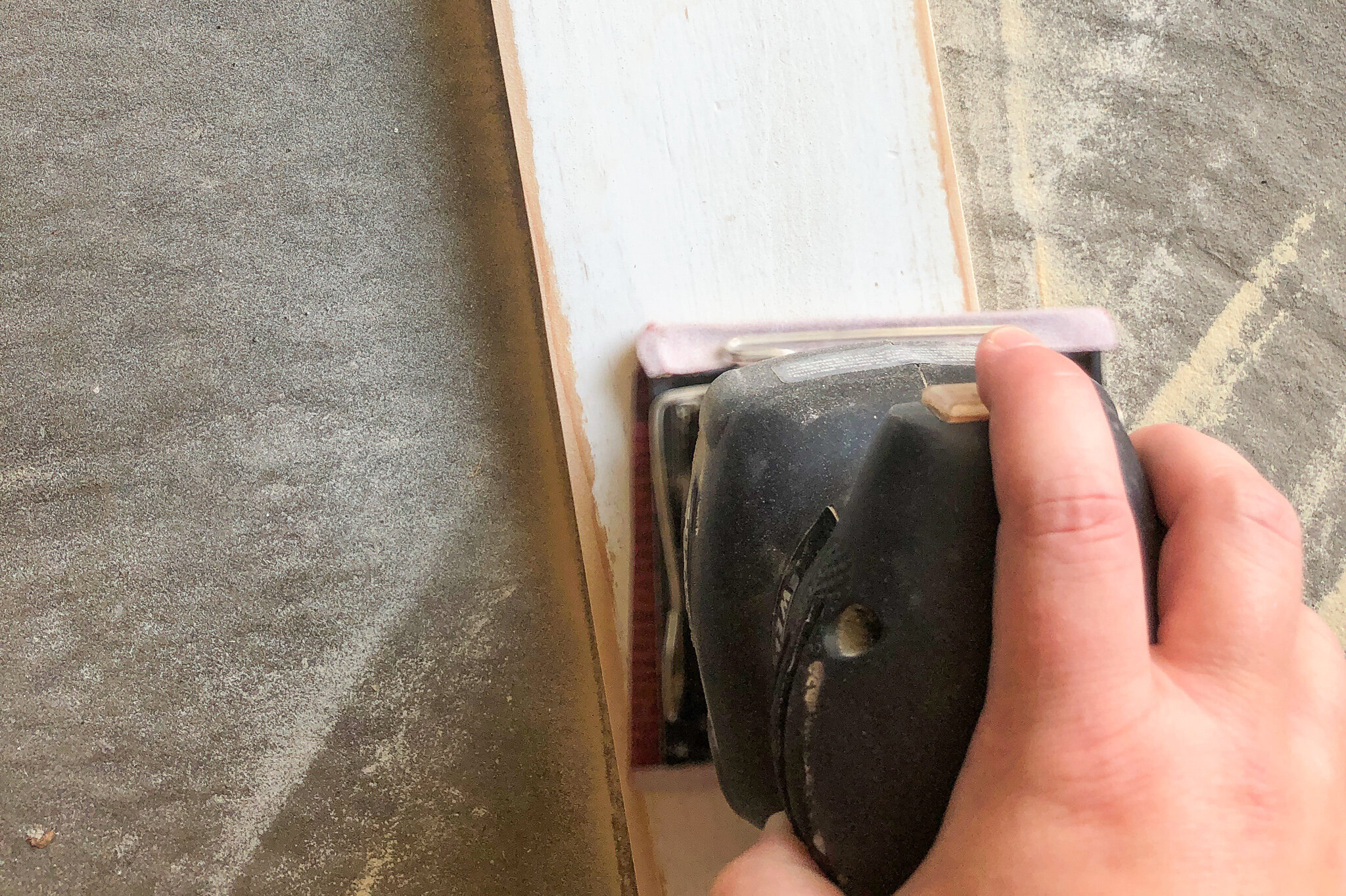 using a sander to create rustic and worn look on wood