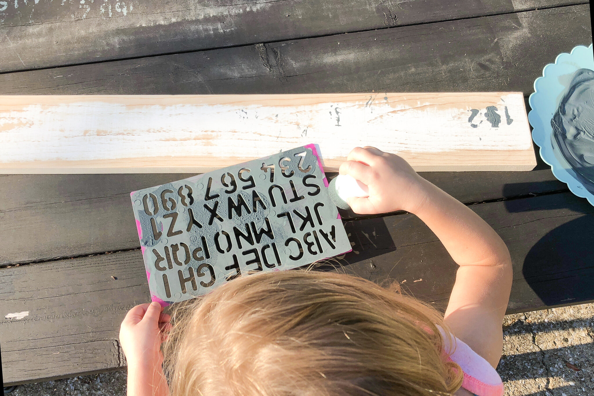Letting kids help you with DIY projects - I had my 4 yr old help me create an unintentional weathered look on this piece of wood.