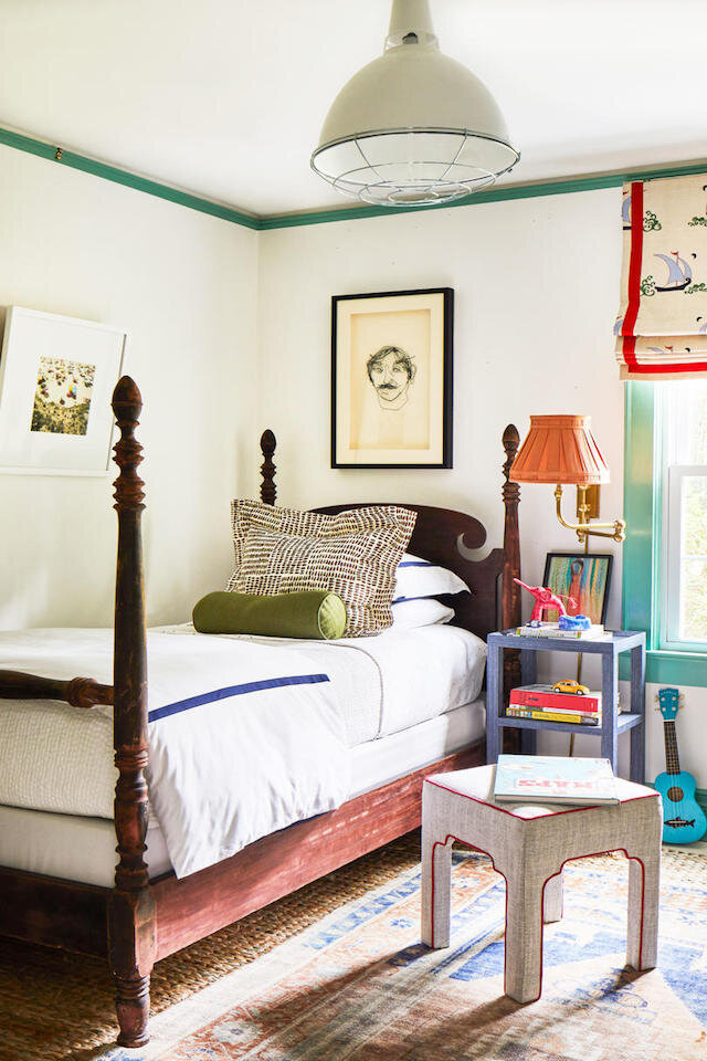 designer Whitney McGregor's kid's room, featured in Southern Living, boasts cozy, traditional cottage decor. Even with a Queen Elizabeth-style bed, the schoolhouse factory pendant looks right at home!