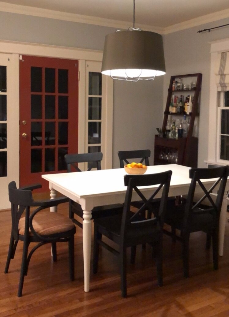 bungalow dining room at night with schoolhouse fixtures