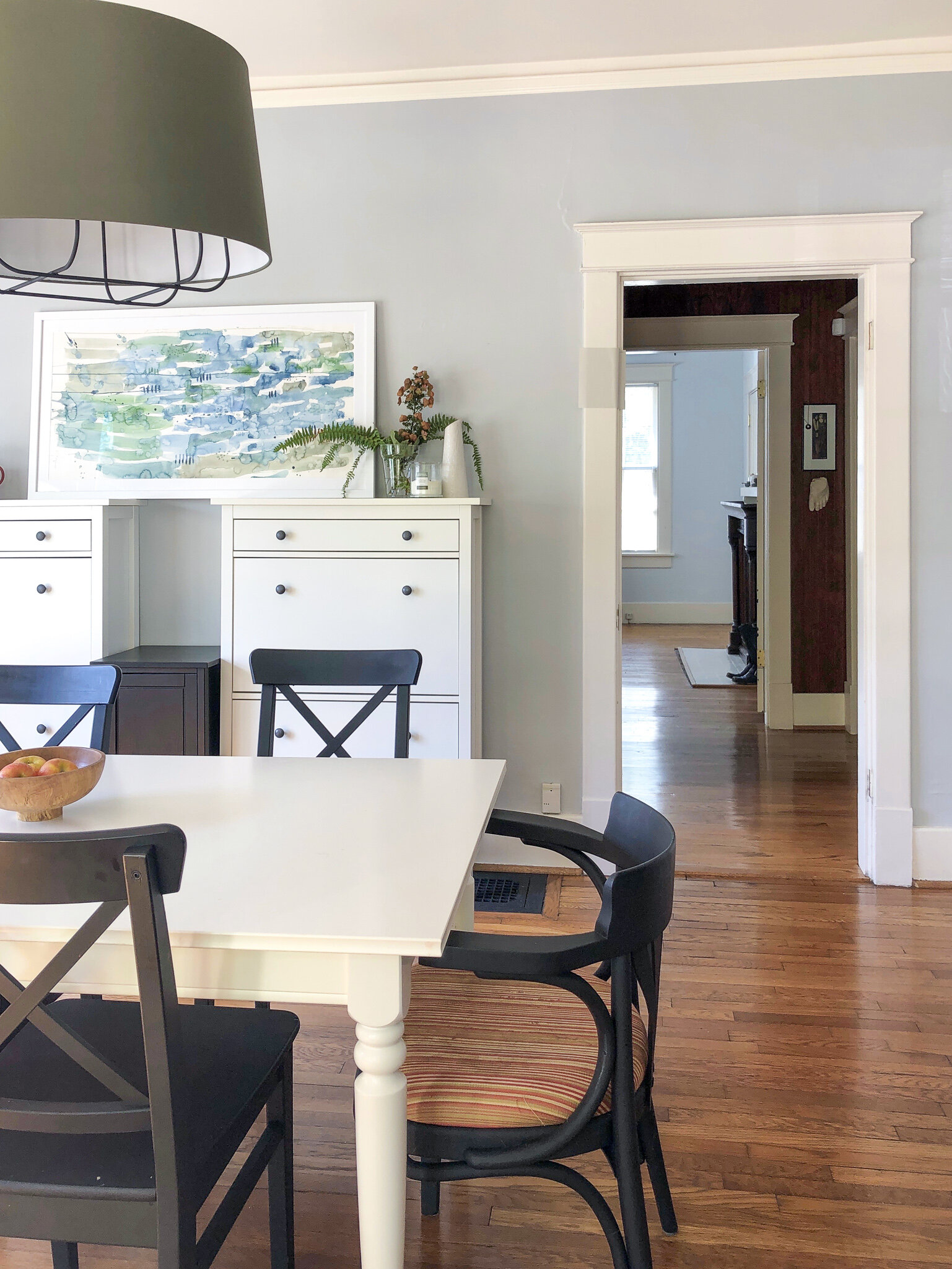Vintage Cottage Style - A California Bungalow in Nashville TN gets the designer touch on a serious budget. After years of neglect from landlords, this California Bungalow is being lovingly restored to its former glory with touches of industrial and schoolhouse style. The result is a casual look for a busy family with lots of heirlooms. #californiacasual #cottagesandbungalows #bungalowstyle #cottagestyle #industriallighting #nashvilletn #historicpreservation #abmlifeisbeautiful