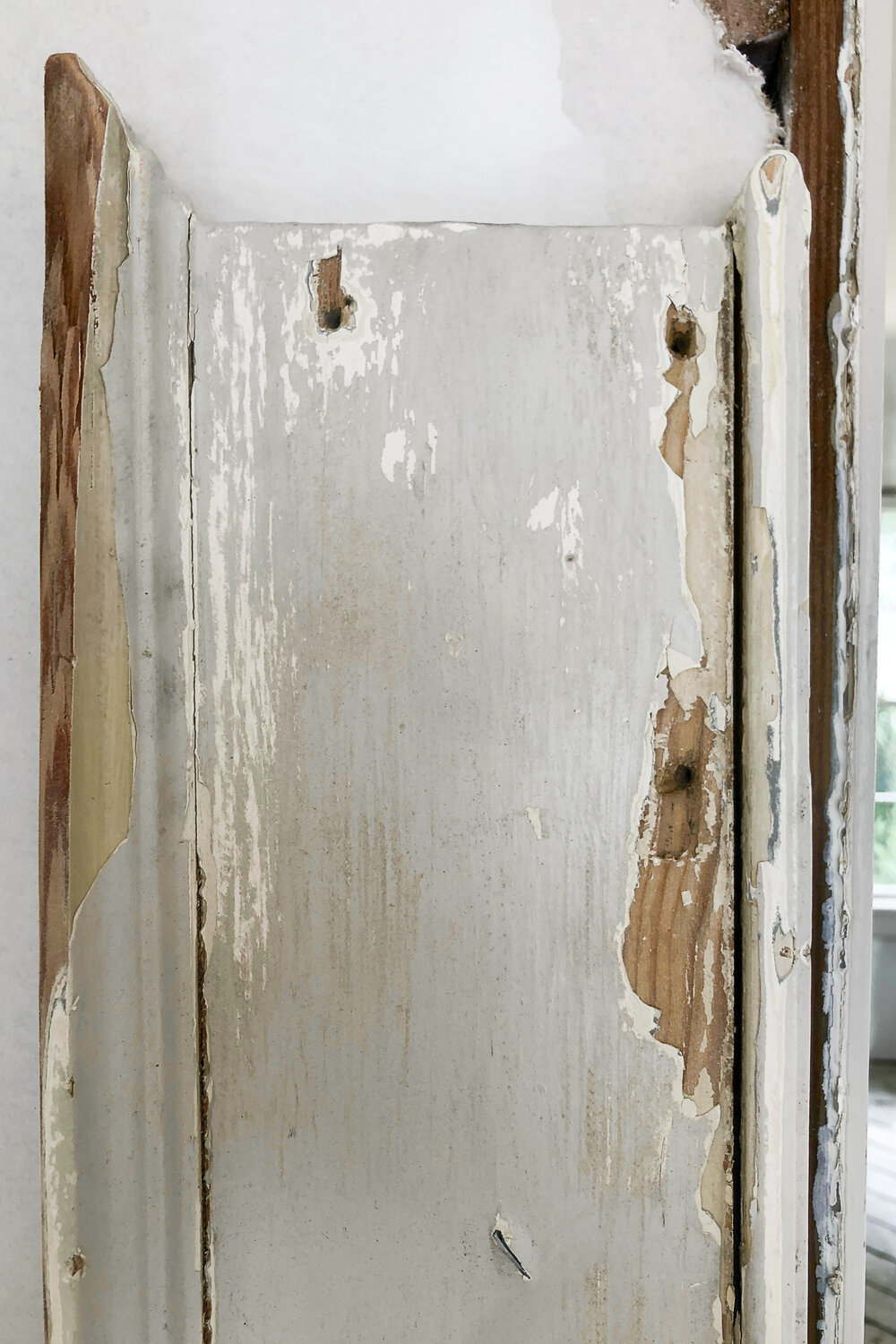 removing chippy paint from old wood house trim