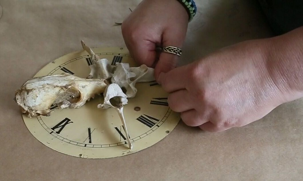 Juliet's hands w:skull clock.jpg