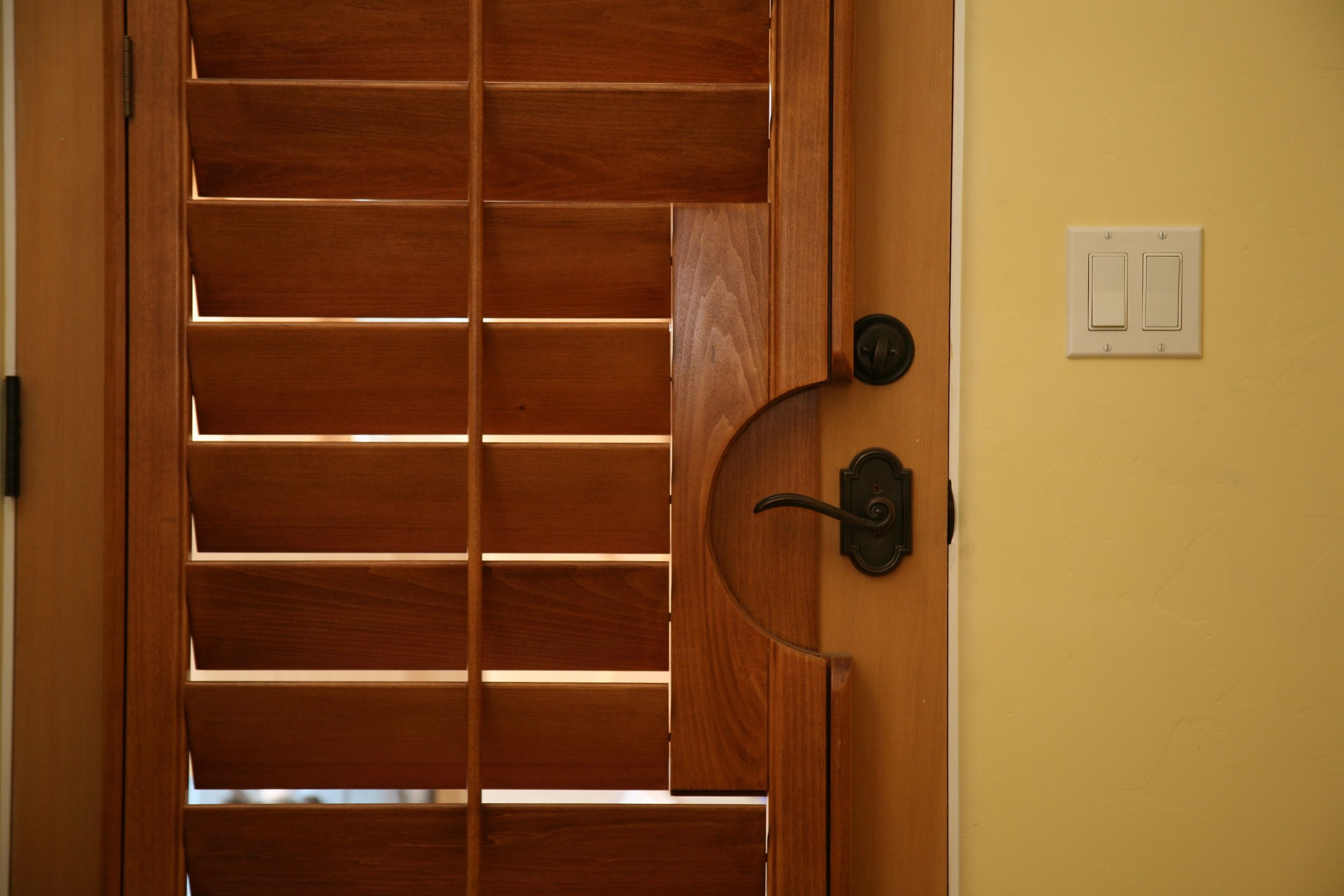 Handle cut-outs for lever-style door handles make opening and closing doors with plantation shutters easier.