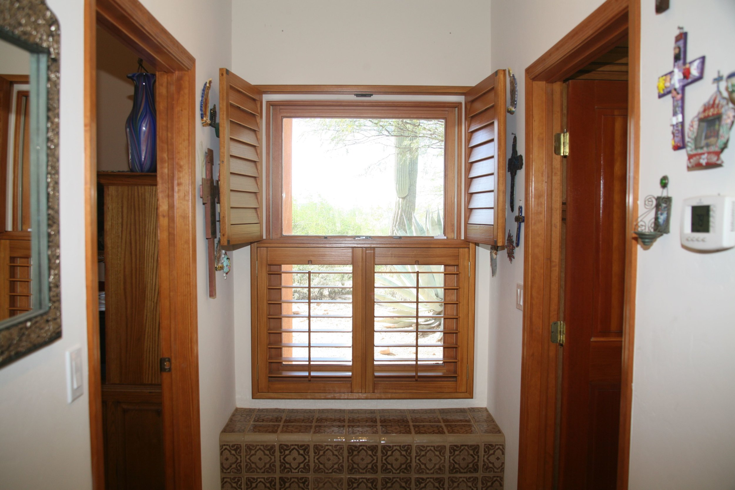 Double-hung shutters provide the option of opening the top or bottom for more light as needed.