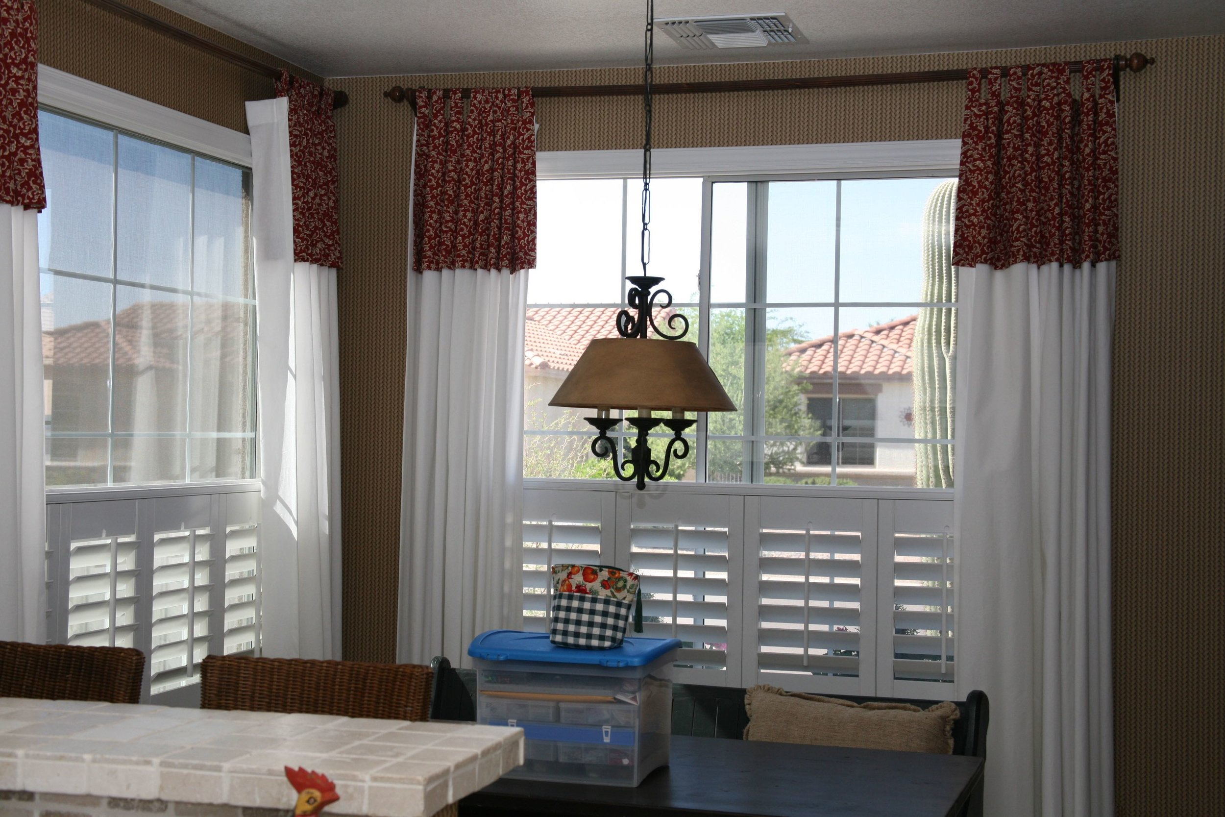 Cafe-style shutters provide privacy in areas where there is no light control issue.