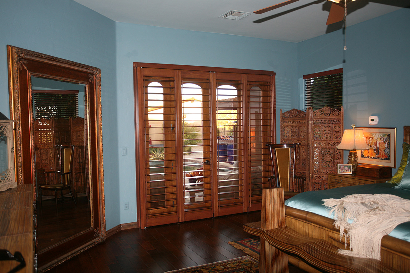 These bi-fold plantation shutter panels were designed to match home aesthetics while covering french doors.