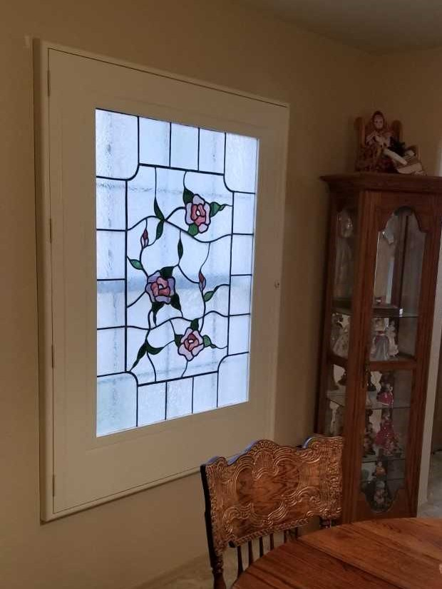 Here, we created a custom frame for a piece of stained glass.