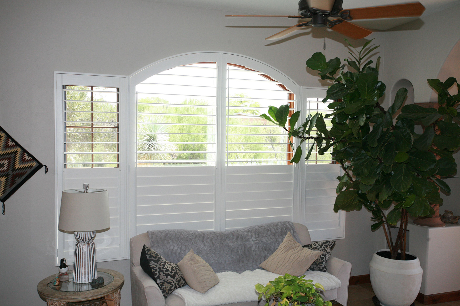 We created fully louvered window coverings that followed the unique shape of the windows in this house.