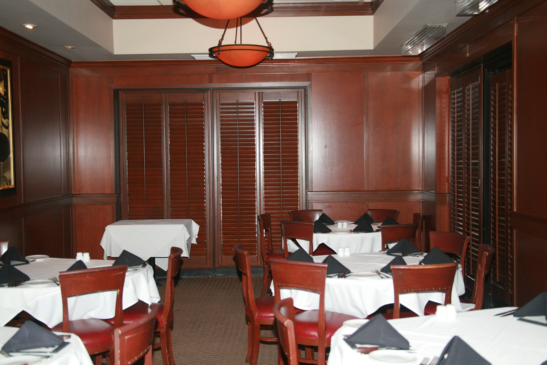 Fleming's - Prime goal was to maintain a rich look of wood throughout the restaurant while gaining light control and privacy throughout the entire building, including the windows and doors.