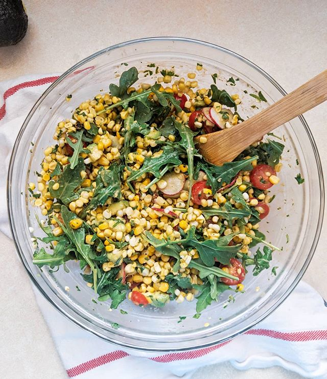 There is no better season for food than summertime. I love the farmers markets, I love my little herb garden, I love the produce available during this time. Everything is fresh and glorious and so much more delicious.  Last weekend I brought this corn salad to a potluck and now I want to make it again just for me...  Feeds a lot: -6 ears of corn -1 avocado -1 pint cherry tomatoes -Juice of 1 lime -1 bunch cilantro -A few radishes -1 or 2 handfuls arugula -1-2 tbsp chili powder (I used the chili lime seasoning from TJs!) -salt and pepper to taste -dash of cayenne for a little kick  I put half the corn cobbs in a really hot cast iron to get a nice char all over them, then let them cool. Cut all the corn off the cobbs (do it right in the bowl you're using to avoid mess!)  Thinly sliced the radishes, dice the avocado, slice the cherry tomatoes, dice the cilantro really finely, and add that & everything else to the corn. Mix it and add salt as you see needed. Serve cold!