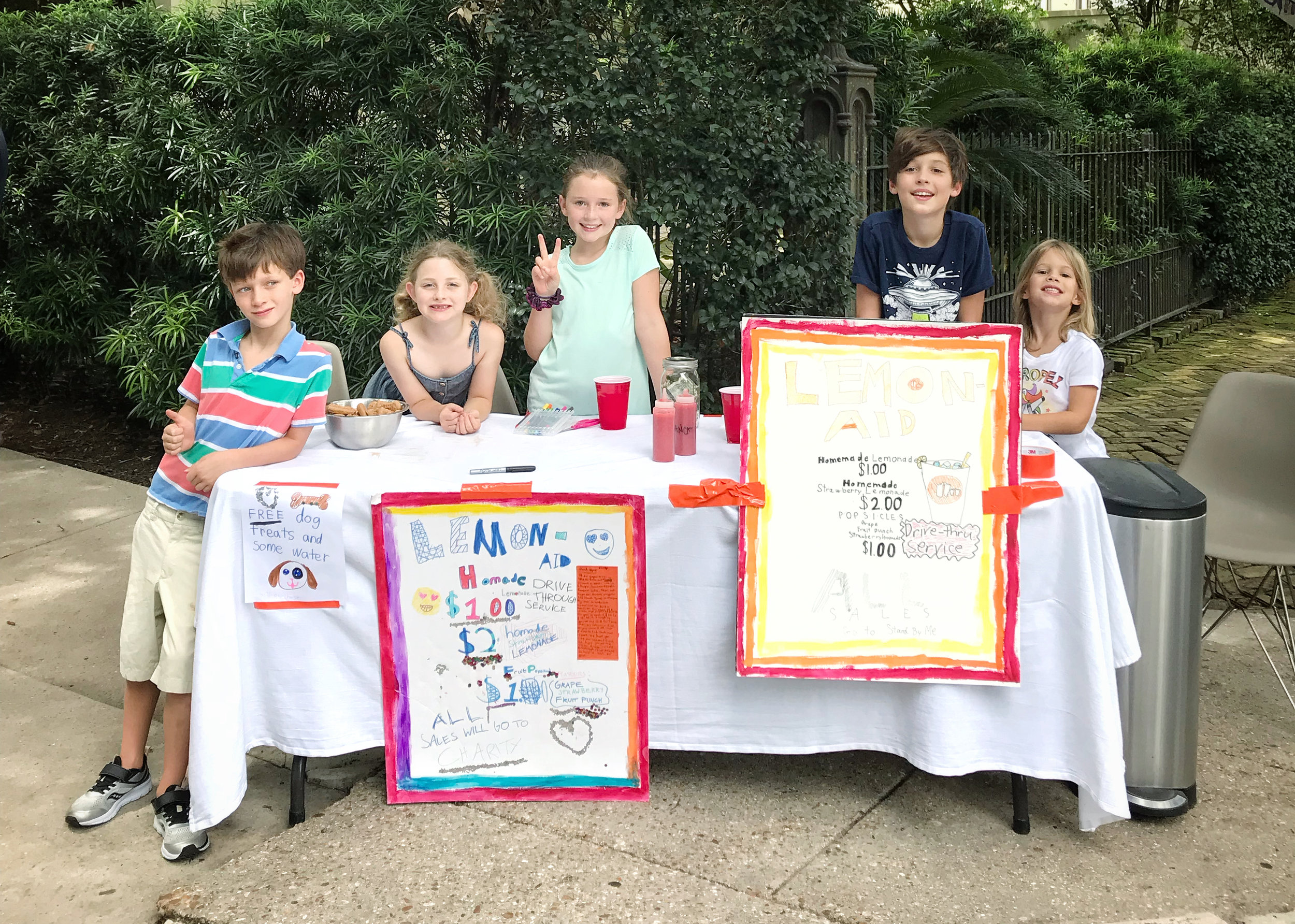 Lemonade for Stand By Me - Powers, Grace and Teddy Bride Mayor recruited a few friends and hosted a lemonade stand for Stand By Me this summer. Stand included free dog biscuits (with purchase) as well as a print out of what Stand By Me is all about.