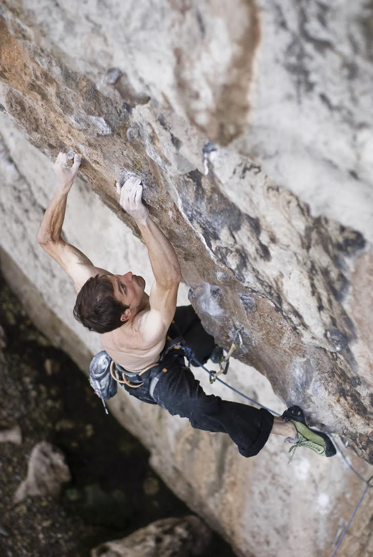 Pete climbing Liquid Ambar - 8C (bloody hard!)