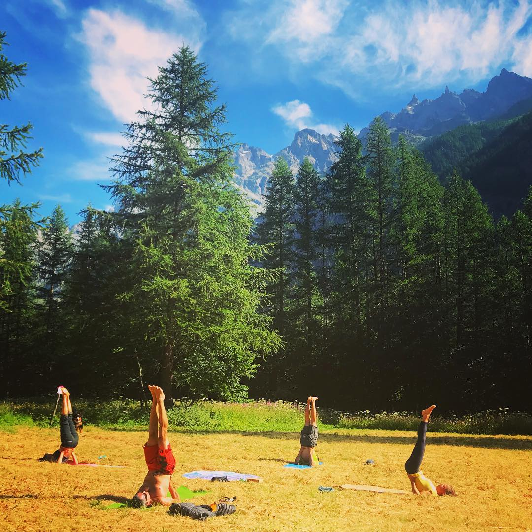 Climbers doing warm up yoga before climbing multi-pitch routes in the beautiful Ailefroide, Ecrins National Park.