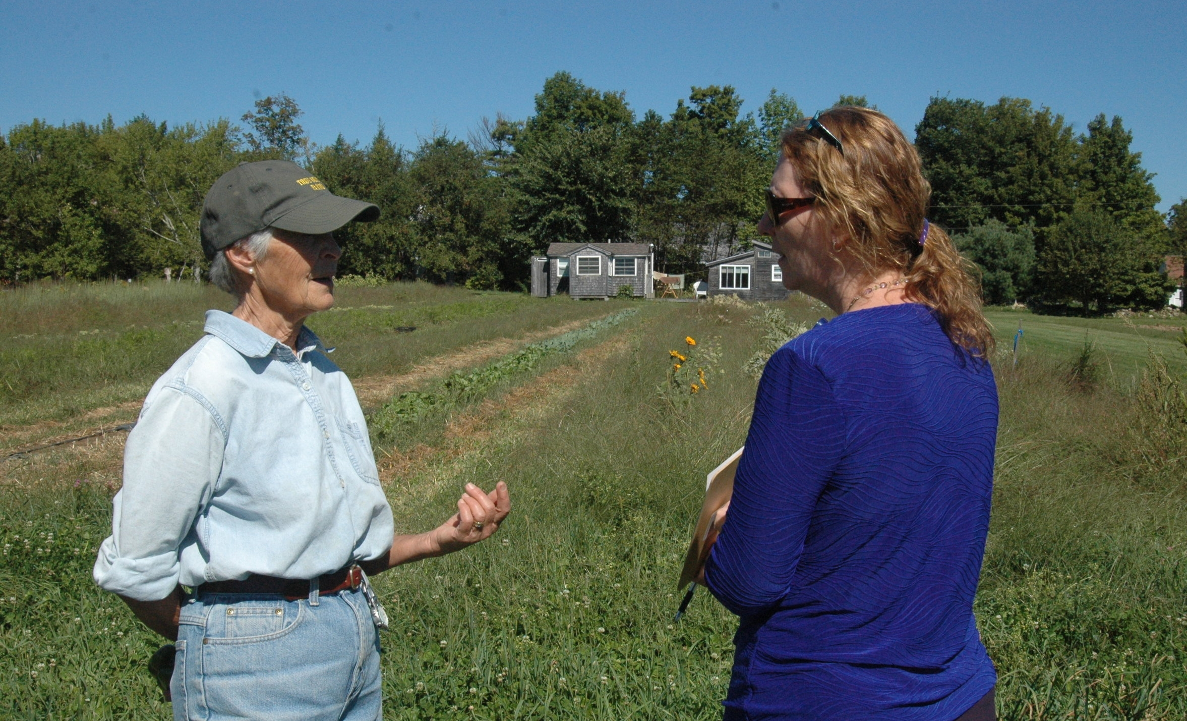 Sheila Costello (Right), Nutrition Director at Waldo County General Hospital, meets with Farmer Sarah Lincoln-Harrison at True North Farms in Montville, ME.