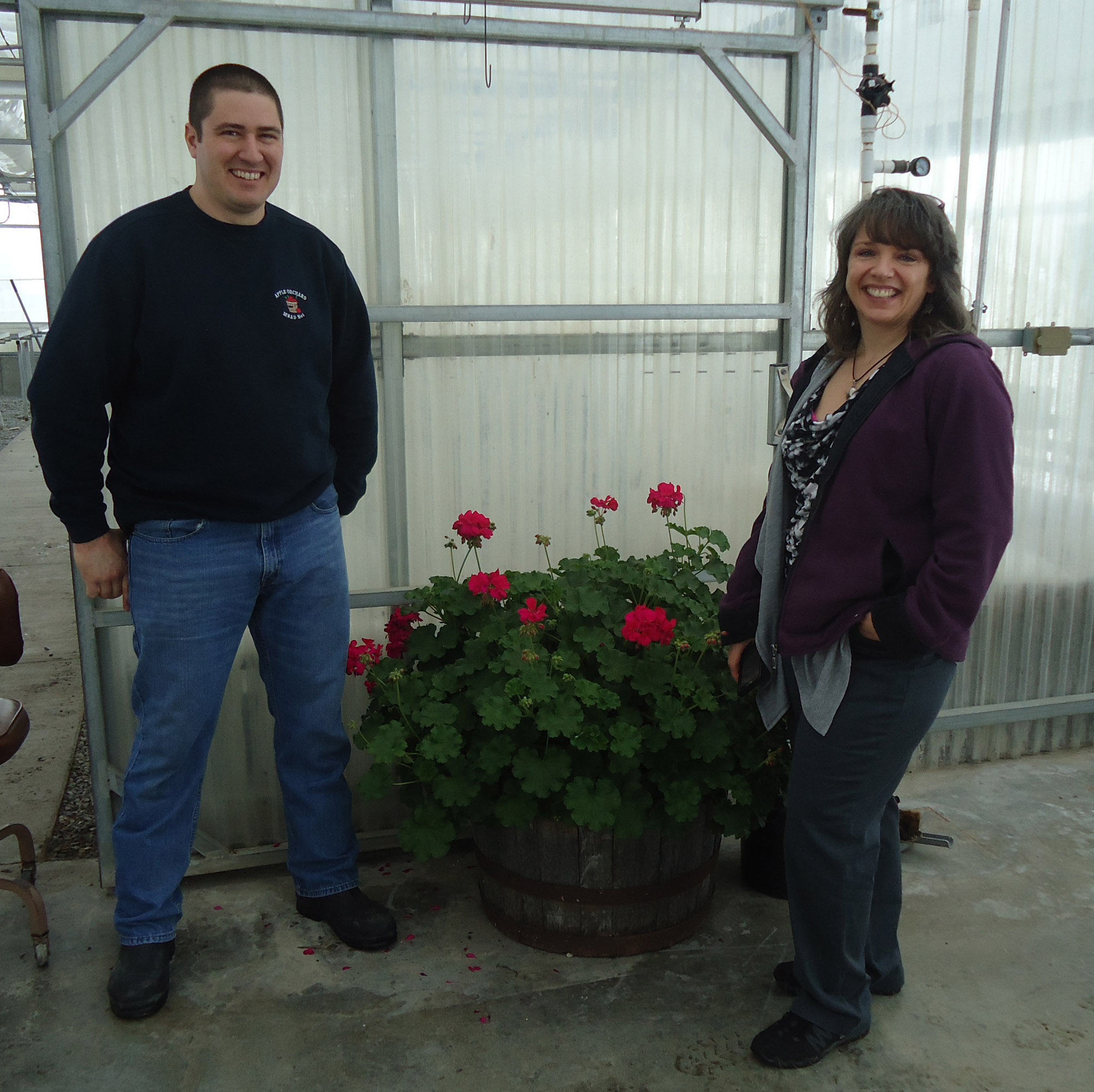 John Hoffses and Renee Page stand inside a greenhouse that John manages for the school farm at MSAD #1 in Presque Isle, Maine.