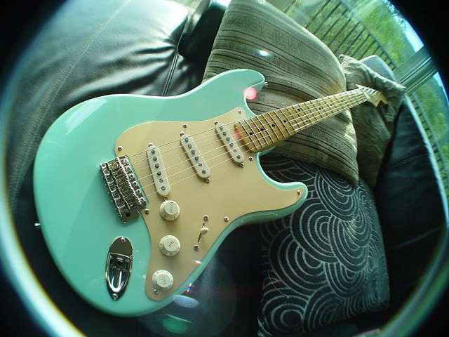 WIDE ANGLE CLOSE-UP: SEAFOAM GREEN, GOLD GUARD, IVORY PLASTIC