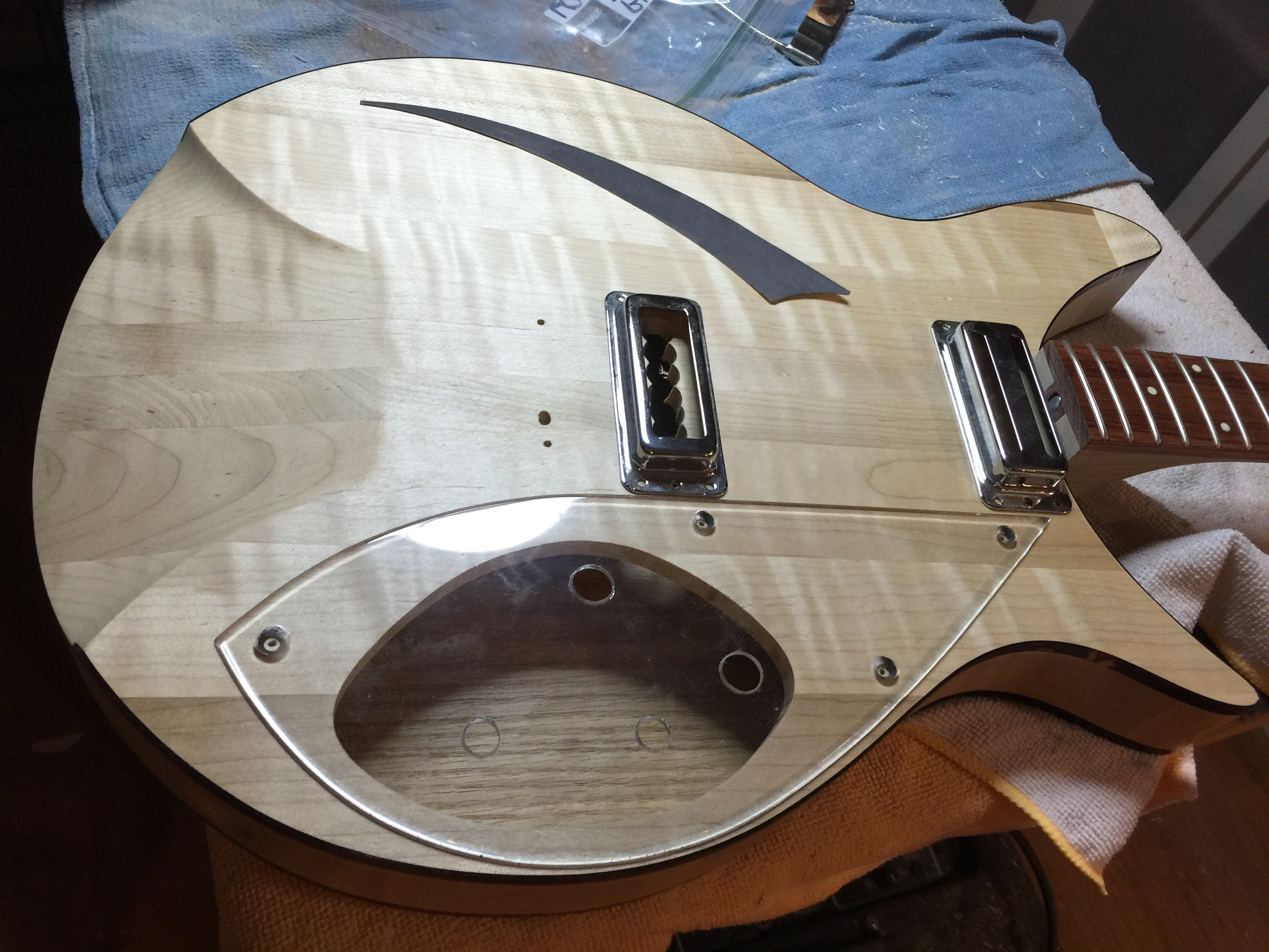 THE THE BODY AFTER SEALING, HAVING THE PICKGUARD AND PICKUPS FITTED