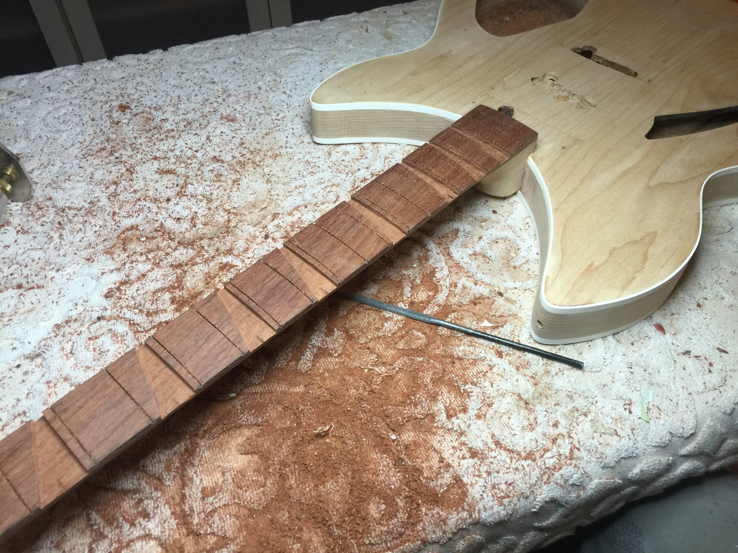 FRETBOARD WAS MODIFIED FOR FULL-WIDTH CRUSHED MOP FRET MARKERS