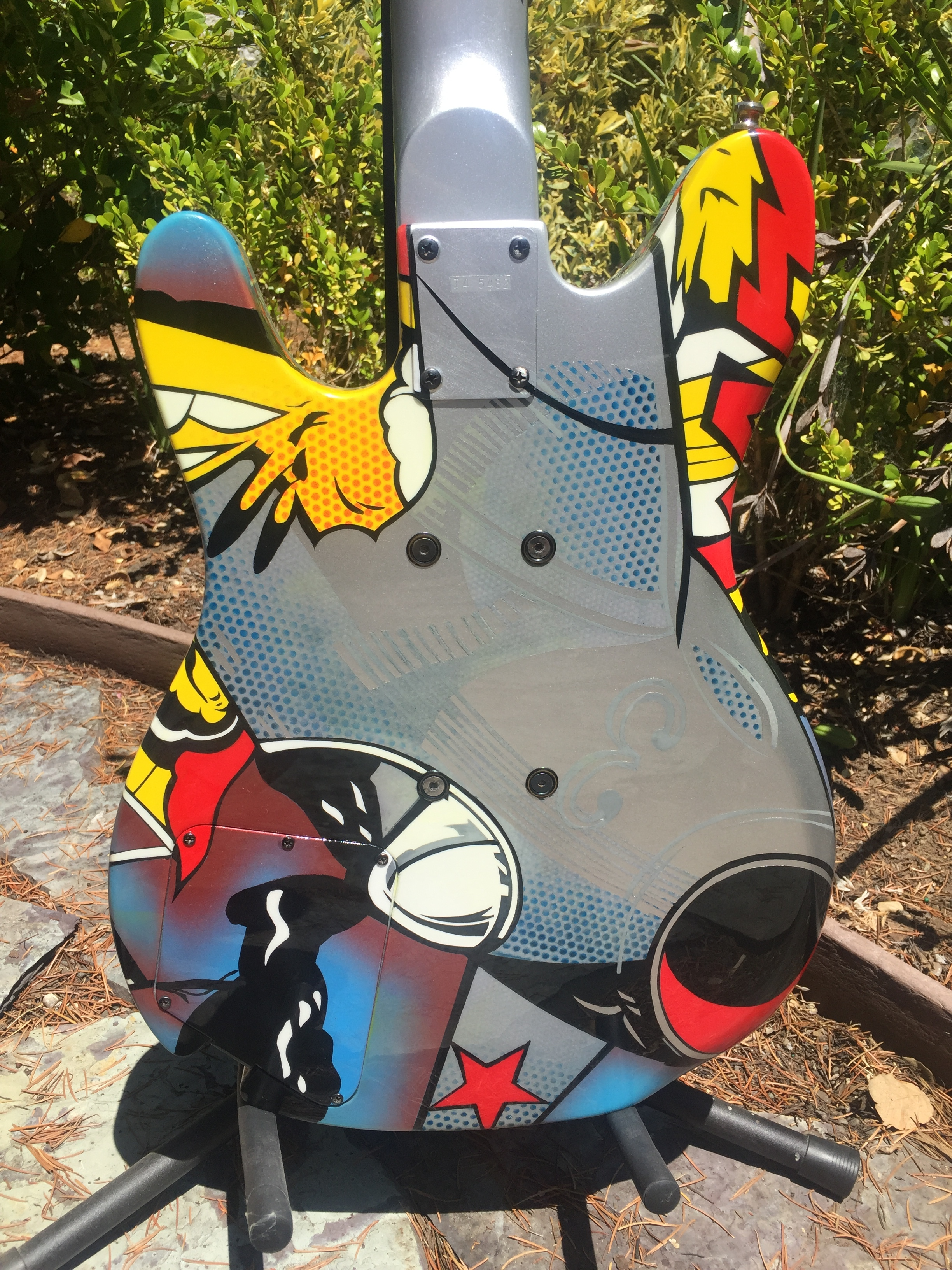 REAR OF GUITAR BODY CONTINUES EXPLODING THEME
