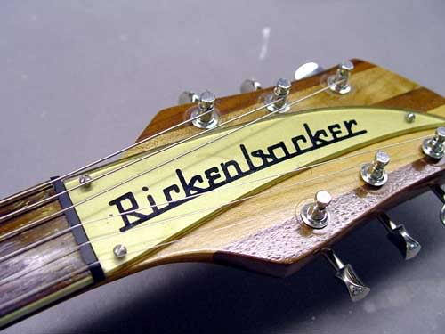 HEADSTOCK SHOWING OLD AMATEUR NITRO REFINISH