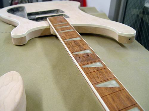 GUITAR BEING TEST-ASSEMBLED BEFORE PAINTING