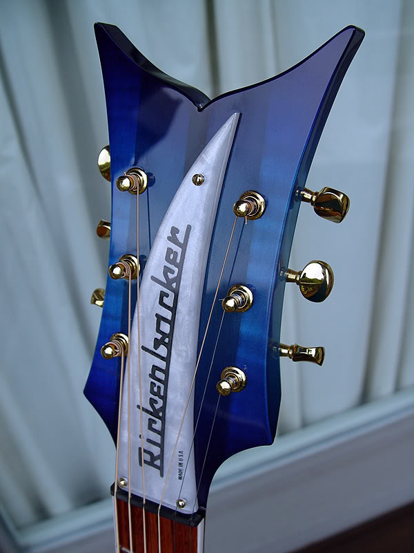 "CLOSEUP OF THE UNUSUAL ""FISHTAIL"" HEADSTOCK"