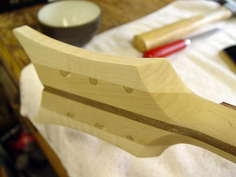HOLES WERE DOWELLED BECAUSE HEADSTOCK WAS PREVIOUSLY USED AS A PATTERN