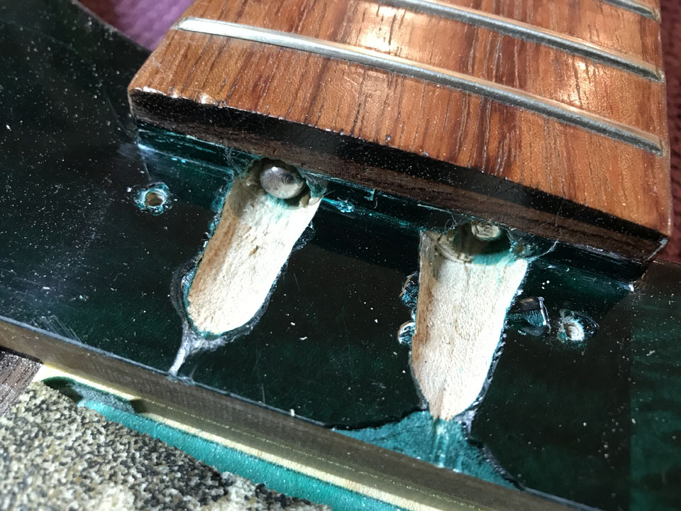 TWO GROOVES HAD BEEN GROUND INTO THE BODY FOR TRUSS ROD ACCESS