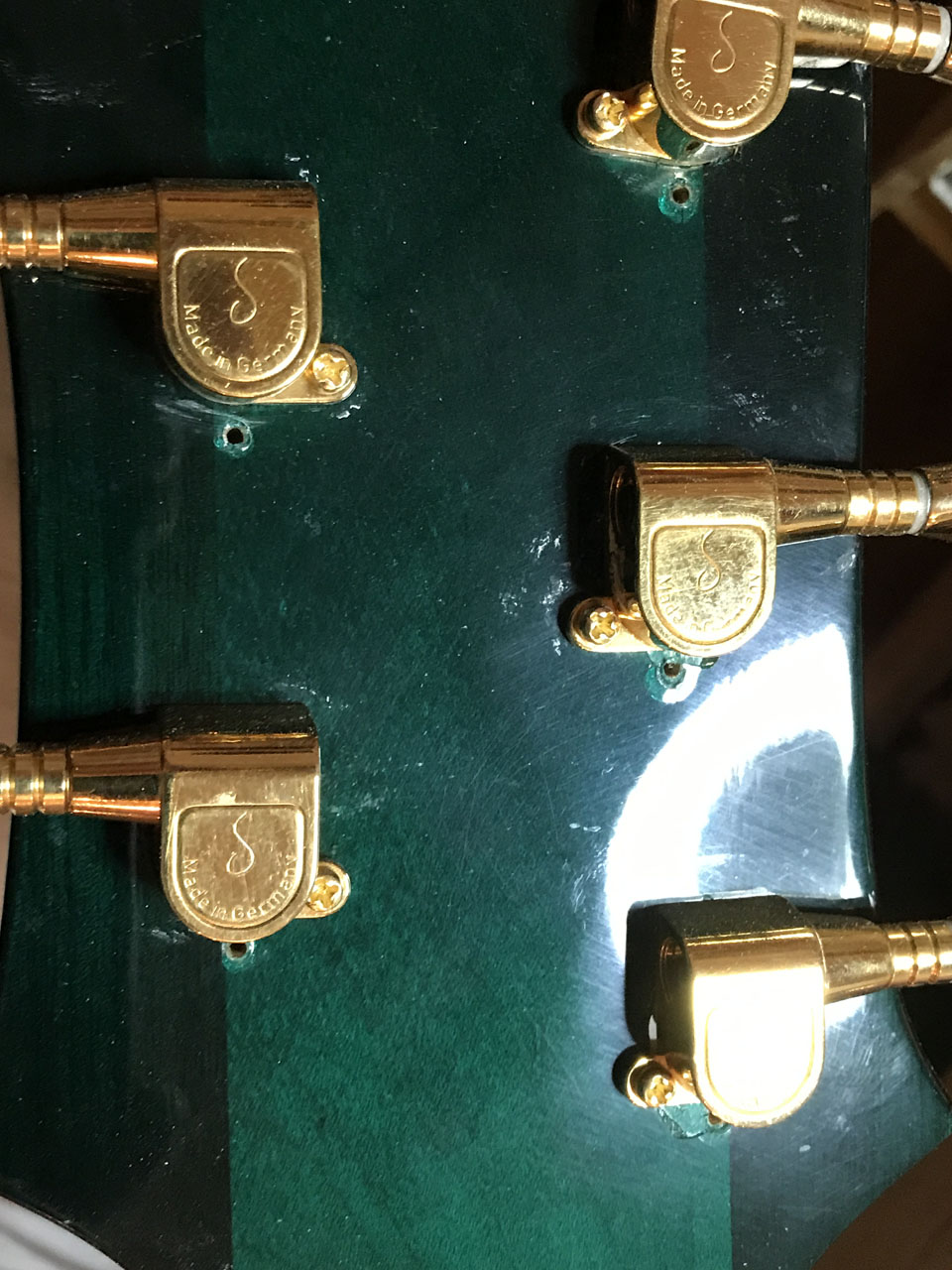THERE WERE AN EXTRA SET OF SCREW HOLES FOR PREVIOUS INCORRECT TUNERS