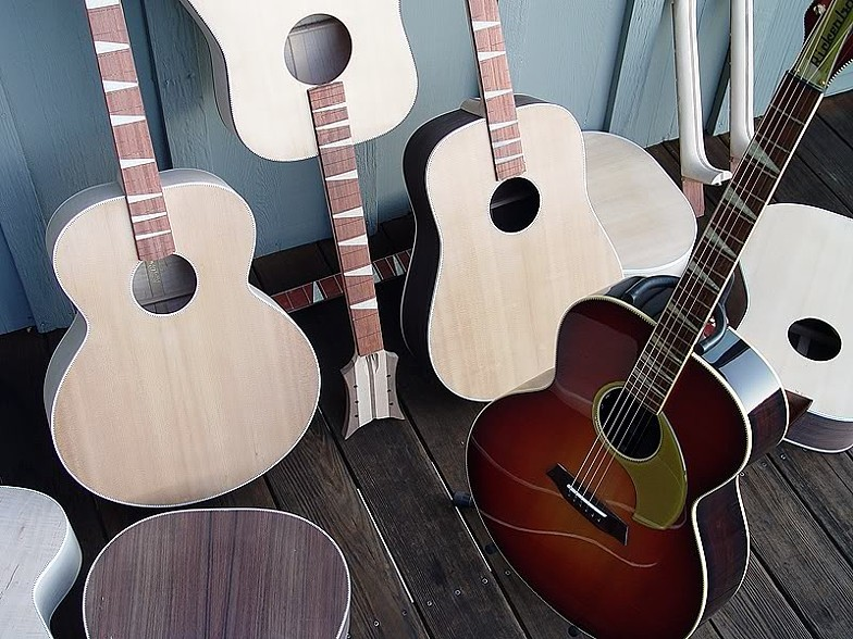 A FINISHED PW ACOUSTIC WITH OTHERS IN VARIOUS STATES OF COMPLETION