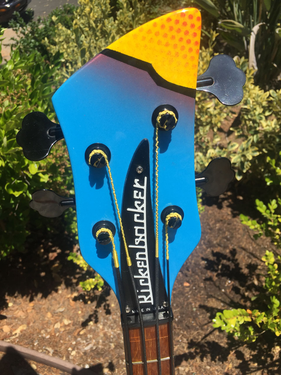 DRAMATIC HEADSTOCK FEATURES COPPER FADE AND DAY-GLO DOTS
