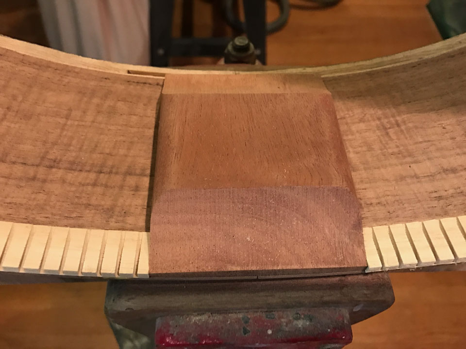 IN THE CLASSICAL GUITAR, THE HEEL BLOCK IS CUT BACK FROM TOP AND BACK TO ALLOW THE ENTIRE SURFACE TO VIBRATE AS ONE PIECE.
