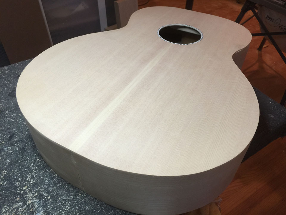 """THE FINAL-TRIMMED BODY STILL NEEDS MUCH WORK: BINDING, NECK DOVETAIL, BOTTOM """"FLASH"""" MUST BE CUT AND FITTED. THIS BECAME THE """"BLUEBURST"""" JUMBO WHICH WAS USED TO RECORD THE ACOUSTIC SOUND SAMPLES."""
