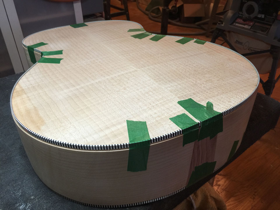 BINDING IS TAPED WHILE GLUING TO HOLD THE CURVE OF THE BODY. THE FITMENT MUST BE VERY TIGHT AND PRECISE; NO GAPS ARE PERMITTED.