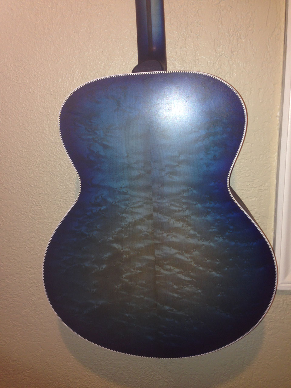 """THE """"BLUEBURST"""" COLOR COATS ARE SPRAYED. BINDING IS TAPED AND ALSO SCRAPED. THIS STEP LOOKS DULL; CLEAR COATING BRINGS OUT BOTH COLOR AND DEPTH OF GRAIN."""