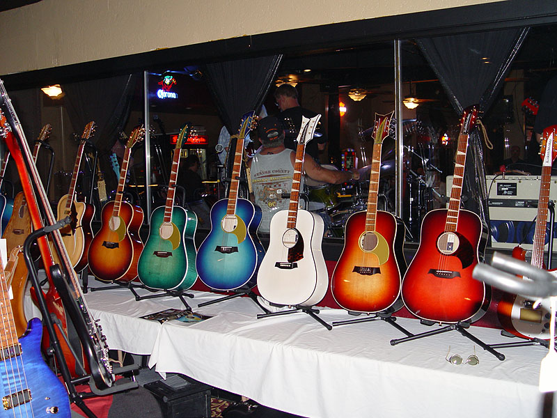 A group of 9 Studio California-built Rickenbacker acoustic guitars, as shown at a Rickenbacker convention in 2012.